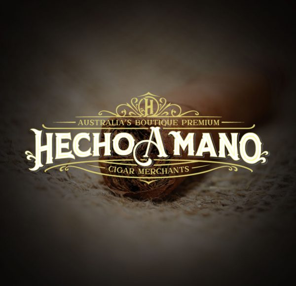 Hecho A Mano Logo on Cigar Background